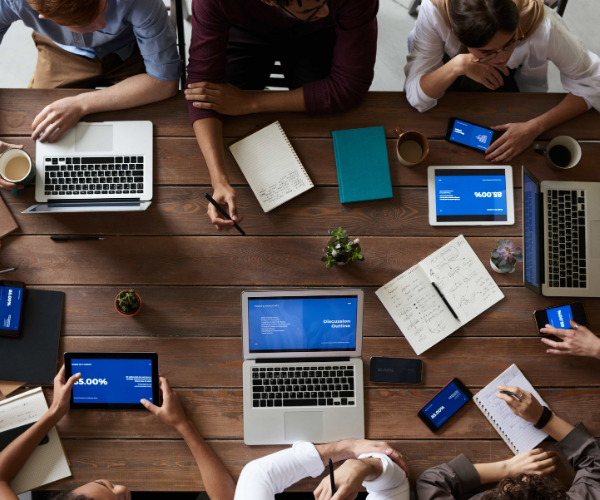 Photo of a team collaborating at a desk.